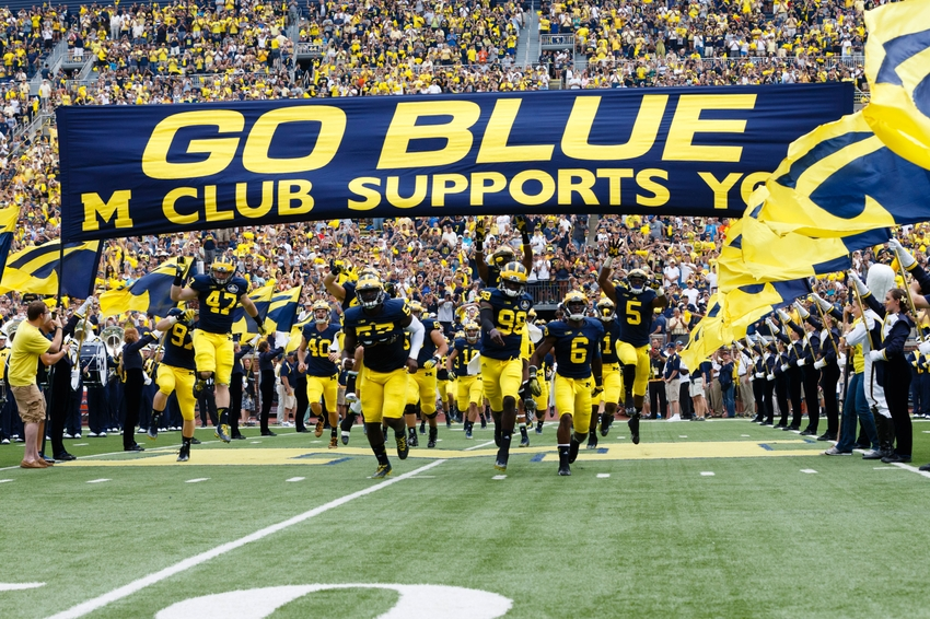 Image result for michigan wolverines run onto the football field