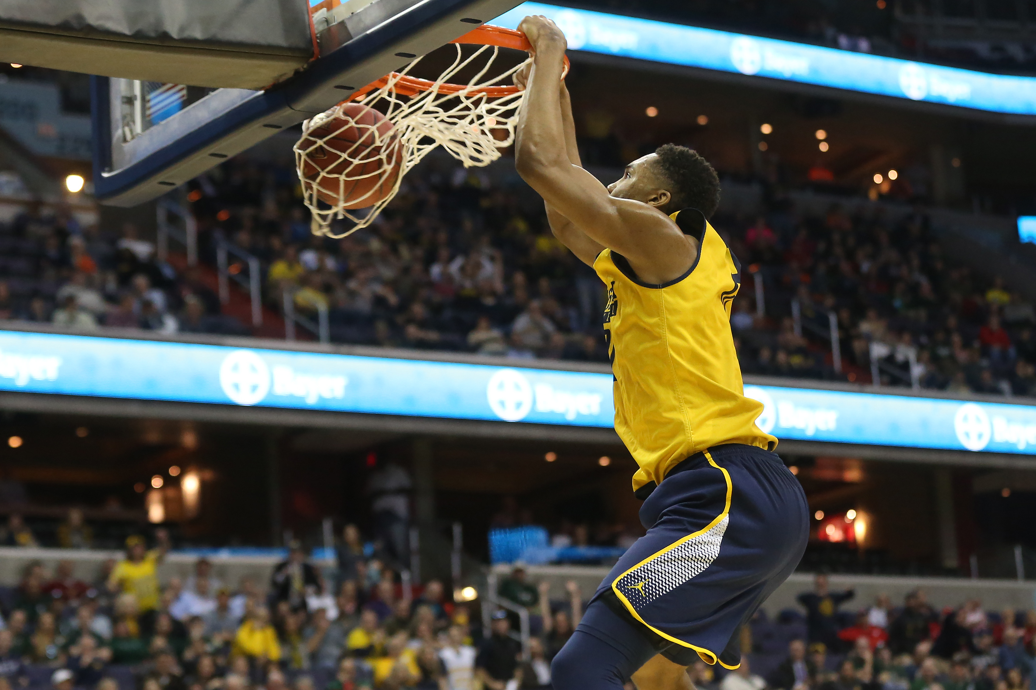 3aee8f938 ... Michigan Wolverines guard Zak Irvin (21) dunks the ball against the  Illinois Fighting Illini in the second half during the Big Ten Conference  Tournament ...